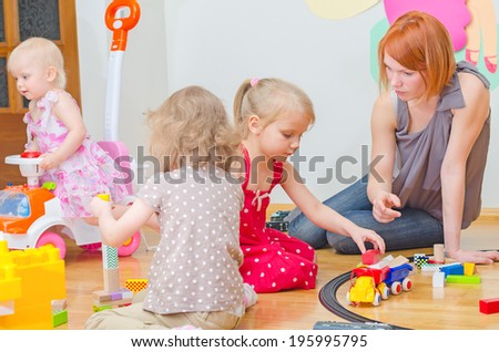 Kids playing in kindergarten. - stock photo