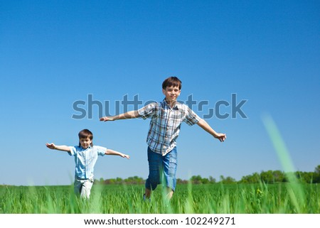 Kids playing in the meadow - stock photo