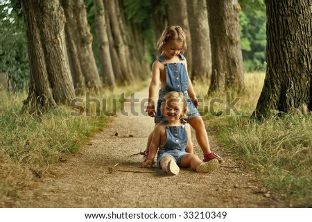 Kids playing in the park - stock photo
