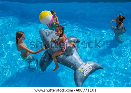 Kids playing in the swimming pool