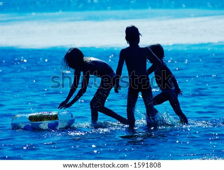 Kids playing in the water - stock photo