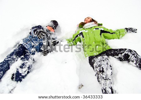 Kids playing on snowy field