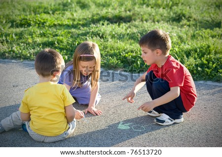 Kids playing on the ground in a sunny day. - stock photo