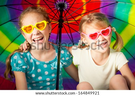 kids playing on the nature with an umbrella - stock photo