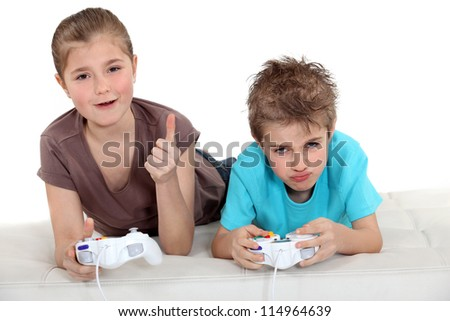 Kids playing video games - stock photo