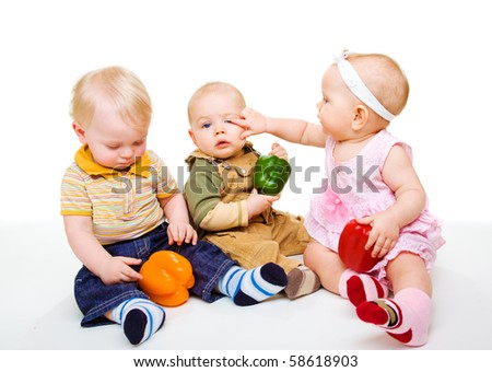 Kids playing with colorful vegetables - stock photo