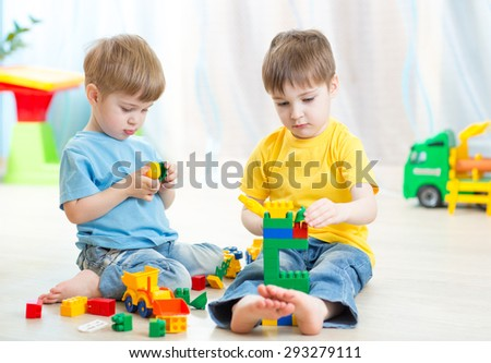 kids playing with constructor toys - stock photo