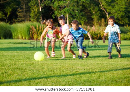 Kids playing with the ball - stock photo