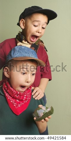 Kids playing with toy grenade - stock photo