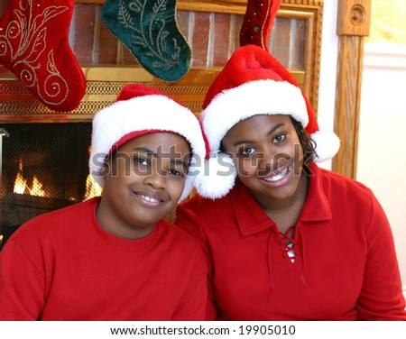 Kids posing for Christmas photos - stock photo