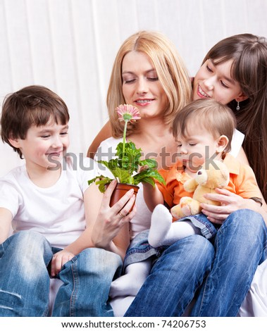 Kids presented mother a Gerber flower - stock photo