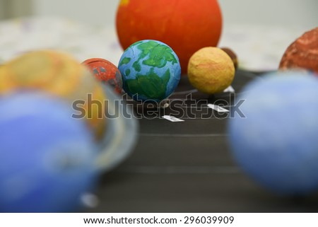 Kids presenting their science home project at school - chart showing the planets of our solar system prepared for education purpose for students. - stock photo