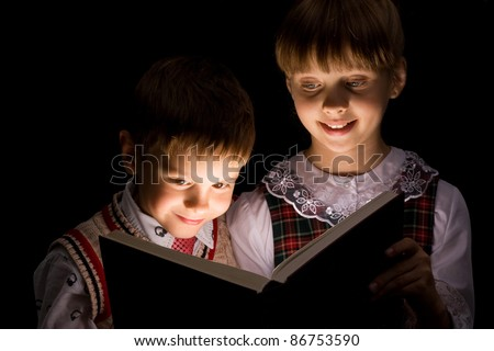 Kids reading the Book. Education - stock photo