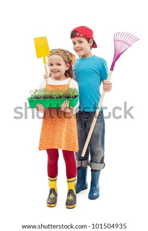 Kids ready to plant tomato seedlings in the spring - isolated - stock photo