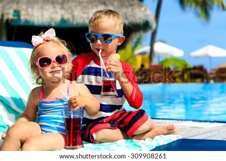 kids relax on tropical beach resort and drink juices, family vacation - stock photo