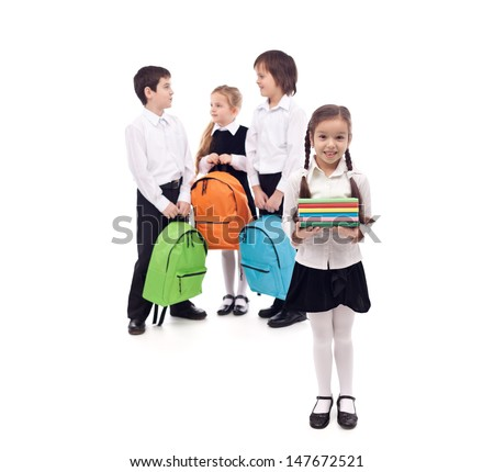 Kids returning to school with books and backpacks - isolated