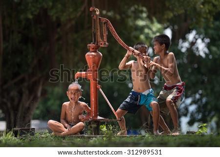 Kids rocking groundwater - stock photo