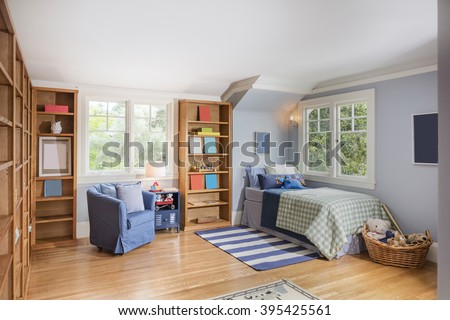 Kids room / teenage room with decorated wooden build ins and wooden floor.  - stock photo