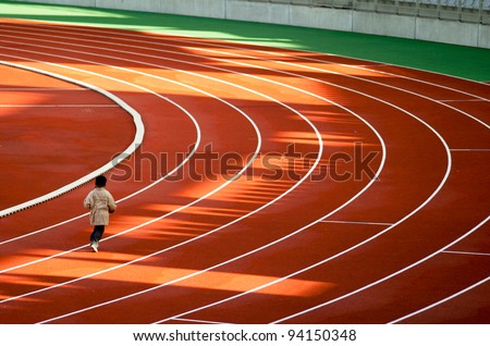 Kids running on tracks - stock photo