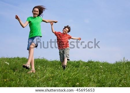 Kids running outdoor against blue sky