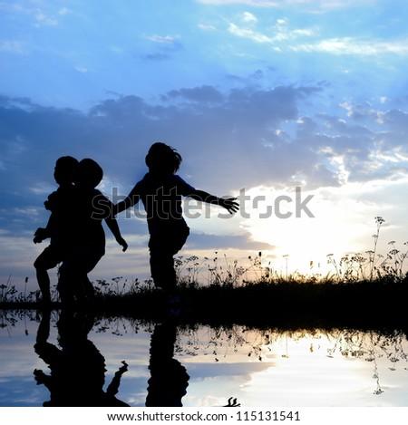 Kids running over the water - stock photo
