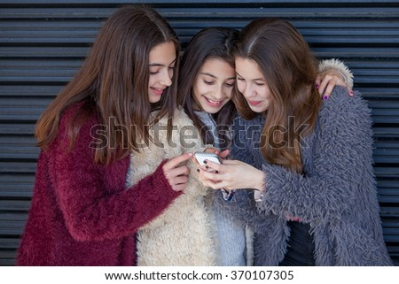 kids sending text message with cell or mobile phone - stock photo