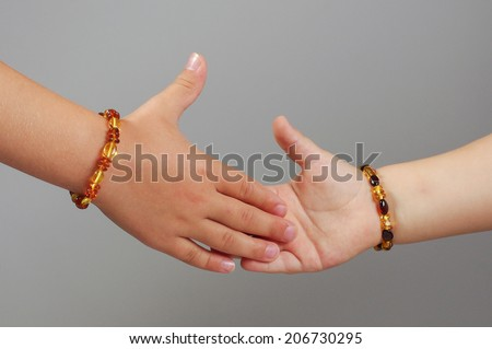 Kids shaking hands body part concept  - stock photo