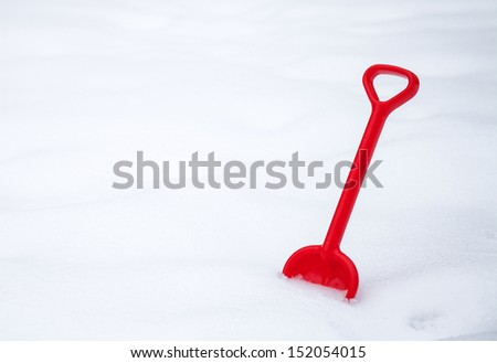 Kids shovel in fresh snow - stock photo