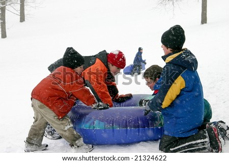 Kids Sledding - stock photo