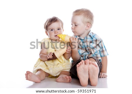 Kids smiling and eating ice cream - isolated - stock photo