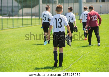 Kids soccer team after game - stock photo