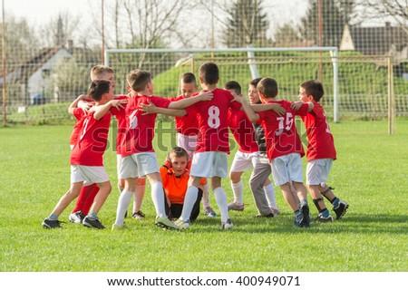 kids soccer team in huddle - stock photo