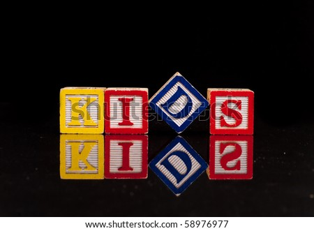 Kids Spelled Out with Reflection - stock photo