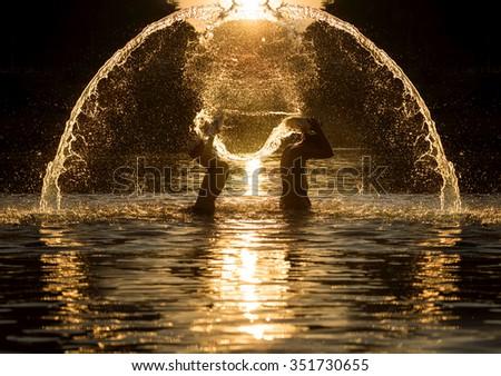 Kids splashing - stock photo