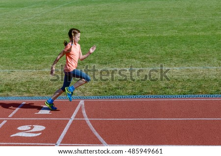 Kids sport, child running on stadium track, training and fitness concept