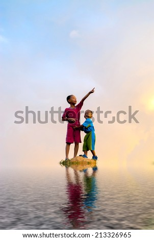 Kids stand in the middle of rock surrounding of water. digital compositing with colour tone, water reflection and ripple effects. - stock photo