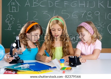 kids students girls group at school classroom - stock photo