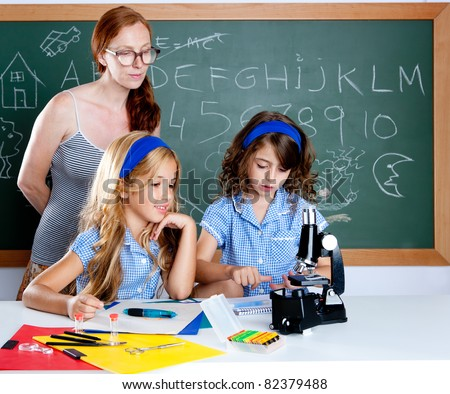 kids students with nerd teacher woman in classroom - stock photo