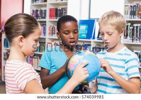 kids studying globe library school stock photo royalty free