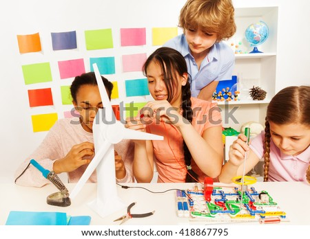 Kids studying the processes of energy transmission - stock photo
