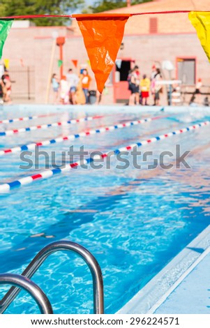 Kids swim meet in outdoor pool during the summer.