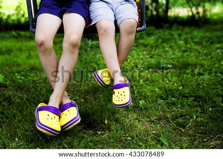 Kids Swinging on yellow shoes