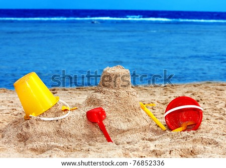 Kids toys on sand beach. Concept. - stock photo