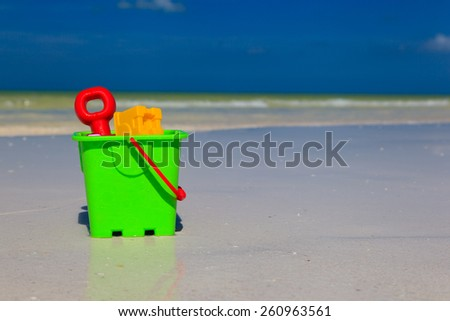 kids toys on summer white sand beach - stock photo