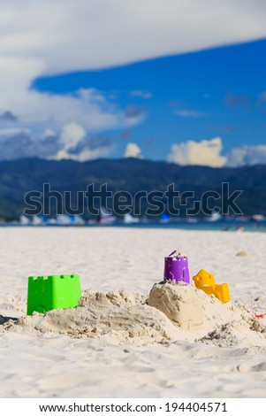 kids toys on tropical sand beach - stock photo