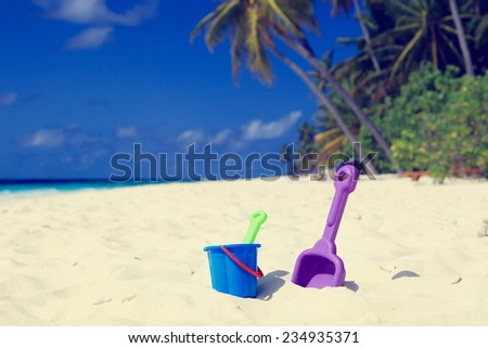 kids toys on tropical sand beach