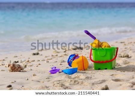 kids toys on tropical sand tropical beach - stock photo