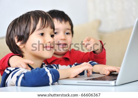 Kids using laptop - stock photo