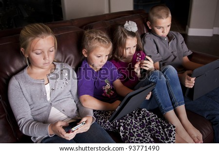 Kids using Mobile Devices - stock photo
