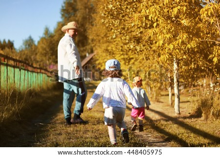 kids walk with grandfather in summer - stock photo